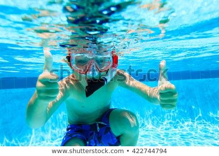 scuba diver in swimming pool and boy Stock photo © galitskaya