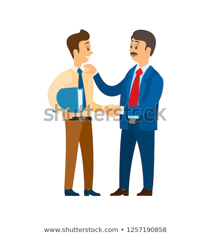 boss praising worker with papers documentation stock photo © robuart