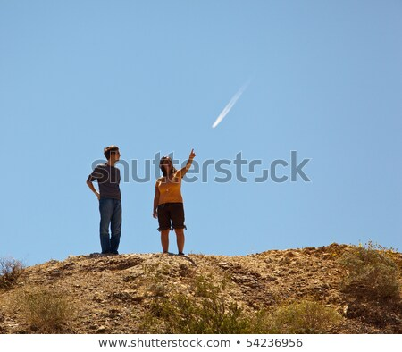 Hikers in desert point to distant object Stock photo © backyardproductions