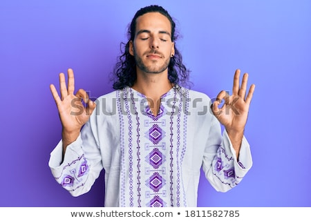 Man in hippie clothes doing the peace gesture Stock photo © colematt