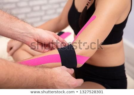 Man Applying Black Physio Tape On Woman's Hand Stock photo © AndreyPopov