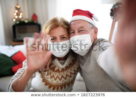 happy senior couple taking christmas selfie stock photo © dolgachov