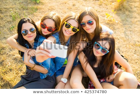 Stock photo: friends taking selfie by smartphone and hugging