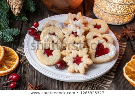 Linzer Christmas cookies arranged on a plate on a rustic background Stock photo © madeleine_steinbach
