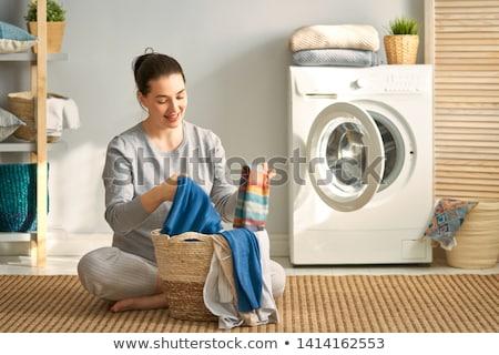 nő · szennyes · gyönyörű · fiatal · nő · mosolyog · otthon - stock fotó © choreograph
