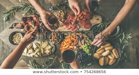 Various wine glasses on wooden table Stock photo © karandaev