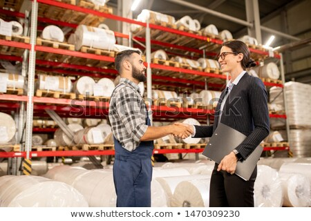 Successful partners handshaking in warehouse of large factory after negotiation Stock photo © pressmaster