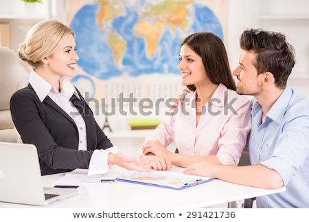 Travel Agency, Woman Looking for Tour for Client Stock photo © robuart