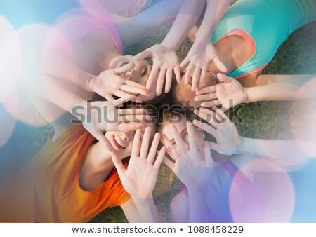 Jovens mãos juntos composição digital mulher grama Foto stock © wavebreak_media