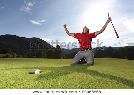 felice · golfista · verde · buco - foto d'archivio © lichtmeister