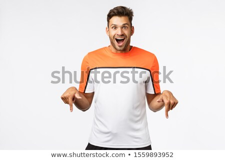 Excited, astonished handsome male in sports t-shirt, amazed receive cool new trainers for christmas, Stock photo © benzoix