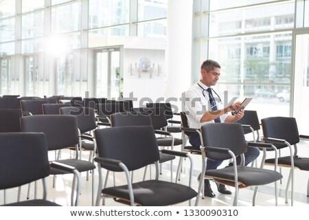 Vista laterale medico seduta sedia digitale Foto d'archivio © wavebreak_media
