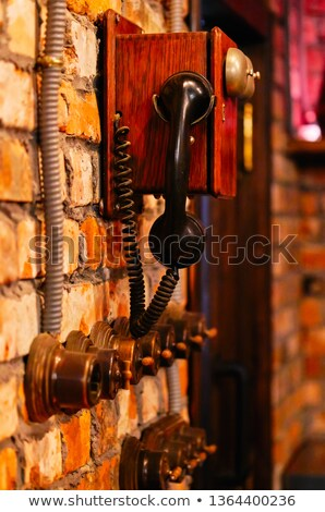Steam punk telephone and turning on off lighting switches  Stock photo © amok