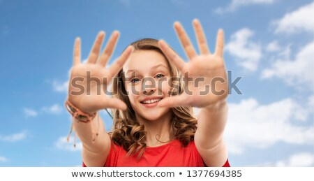 happy teenage girl giving high five over sky Stock photo © dolgachov