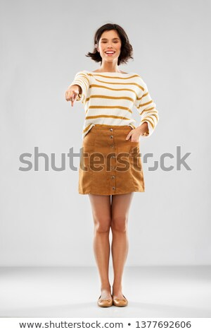 woman in pullover, skirt and shoes pointing to you Stock photo © dolgachov