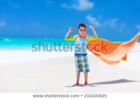 Cute little boy having fun on tropical beach during summer vacation Stock photo © galitskaya