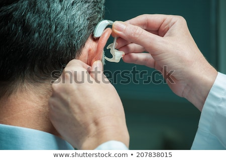 Happy Man Holding Hearing Aid Stock photo © AndreyPopov