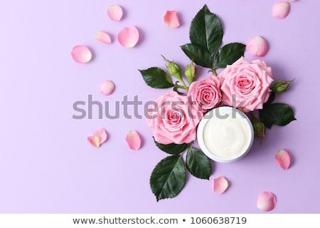 Face cream skin moisturizer on purple roses flowers, luxury skin Stock photo © Anneleven