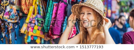 Woman traveler choose souvenirs in the market at Ubud in Bali, Indonesia BANNER, LONG FORMAT Stock photo © galitskaya