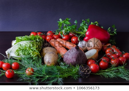 Fresh organic beetroot with green leaves in a basket. Stock photo © Illia
