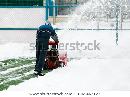 Man using snow blower on snowy drive Stock photo © backyardproductions