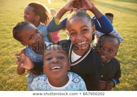 boldog · afrikai · gyerekek · csoport · arcok · égbolt - stock fotó © poco_bw