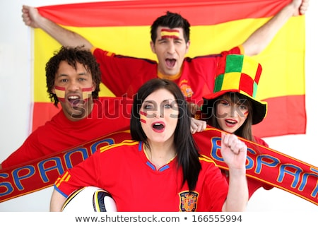a group of people show their support of the spanish football team stock photo © photography33