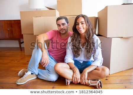 Smiling women sitting in front of stacks of cartons Stock photo © photography33