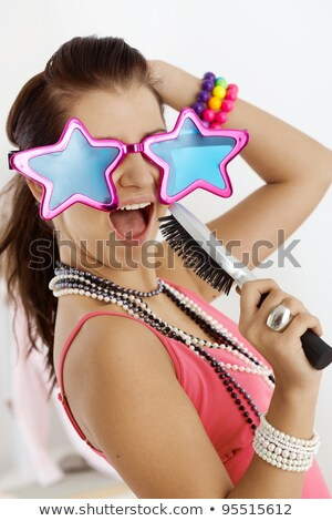 Teenage girl with hairbrush Stock photo © simply