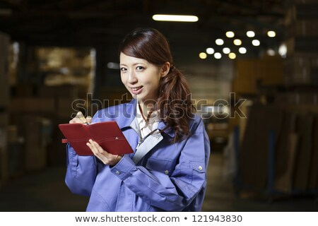 factory worker filling the schedule Stock photo © photography33