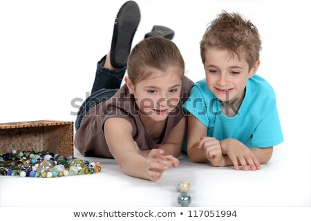 Brother and sister playing with marbles Stock photo © photography33