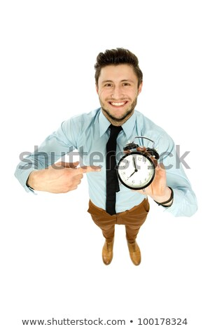 Stock photo: High-angle shot of a businessman holding a clock