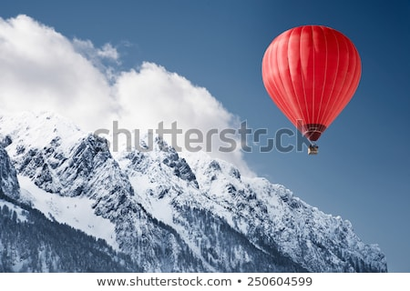 mountain landscape with snow and hot air balloon flying in the sky stock photo © ajlber