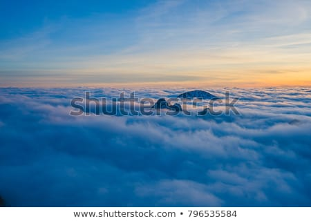 Clouds over the Mountains Peaks Stock photo © RazvanPhotography