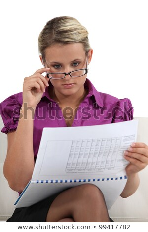 Blond businesswoman going hover her commitments Stock photo © photography33