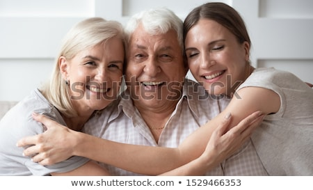 father and daughter snuggling up together stock photo © photography33