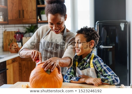Parents with a child and pumpkin Stock photo © photography33