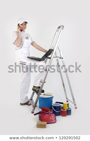 painter posing by ladder with laptop and mobile stock photo © photography33