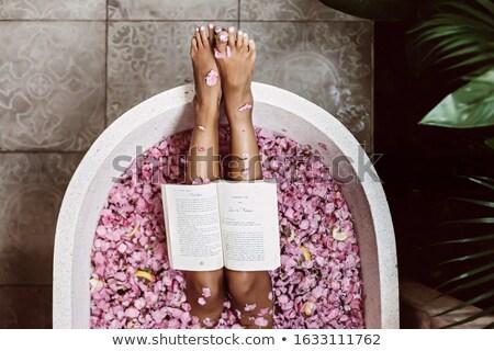 wet woman relaxing stock photo © carlodapino
