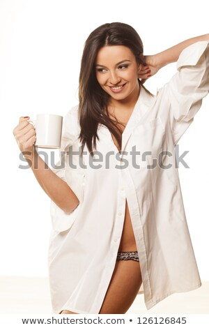 pretty young woman in the mens shirt isolated stock photo © acidgrey