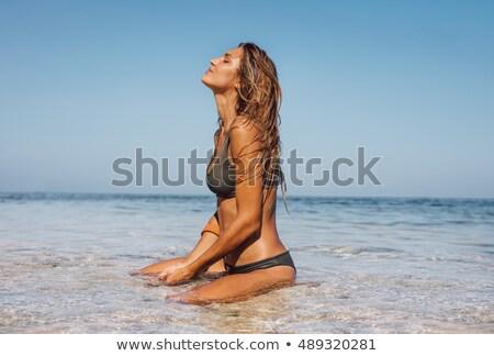 Sensuous young woman in bikini Stock photo © stockyimages