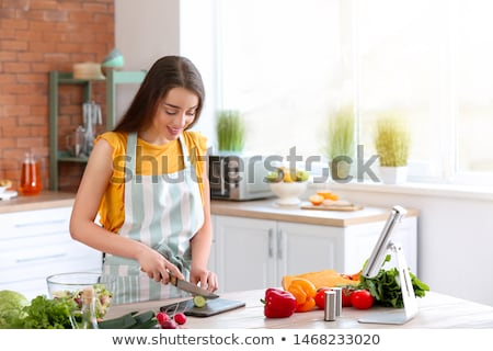 young woman cutting vegetables stock photo © spectral