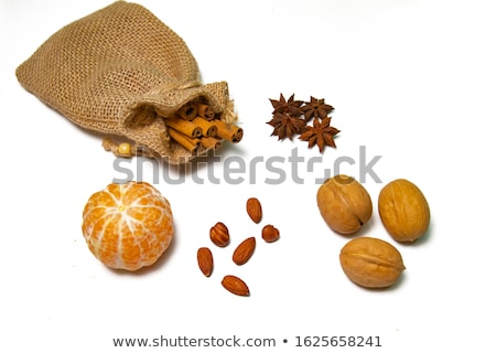 Walnuts, Star Anise and Cinnamon on the Burlap Background Stock photo © maxpro