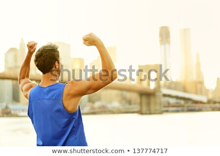 Winning cheering success fitness man in New York Stock photo © Maridav