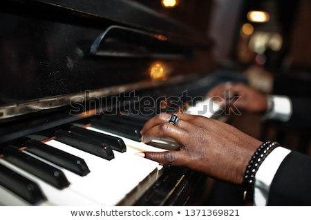 Man's hands playing piano Stock photo © ABBPhoto