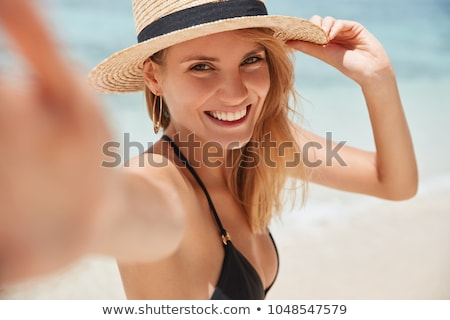 beautiful woman posing in bikini on the beach stock photo © lunamarina