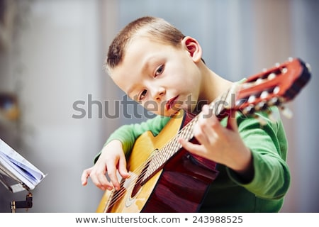 Portrait of Boy holding musical instrument Stock photo © zzve