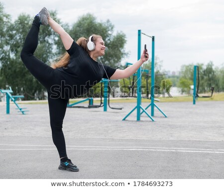 Young smiling acrobat makes splits Stock photo © stepstock