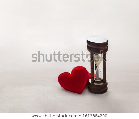 Hourglass with hearts on a white background Stock photo © vladodelic
