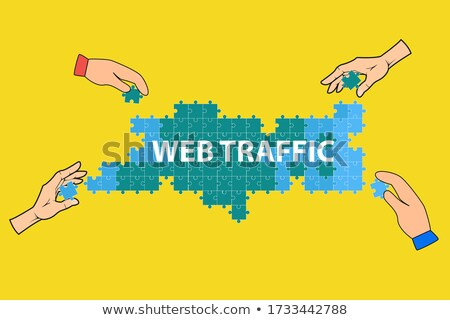 Web Traffic Concept on Green Puzzle Pieces. Stock photo © tashatuvango